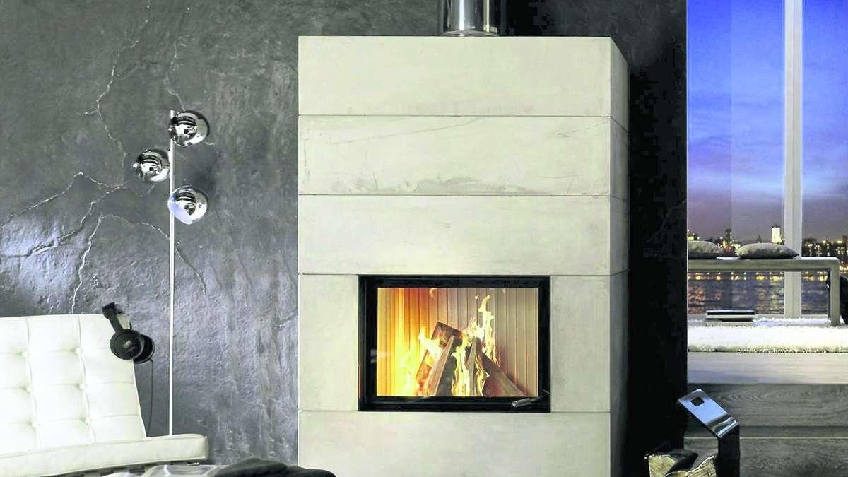 feuerkunstwerk im wohnzimmer mit passendem kamin wohnen. Black Bedroom Furniture Sets. Home Design Ideas