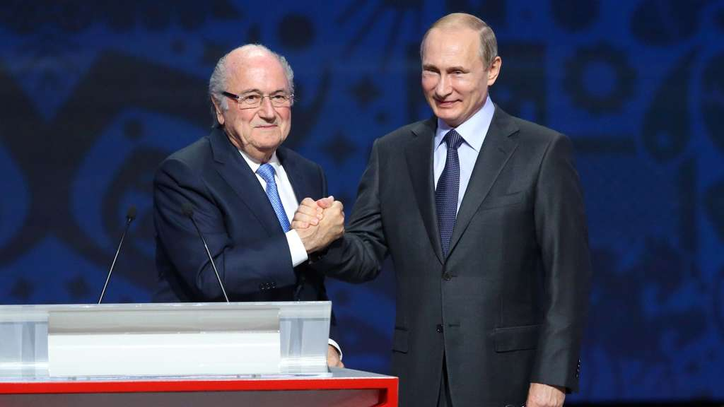 Outgoing FIFA president Sepp Blatter (L) shakes hands with Russian President Vladimir Putin ahead of the preliminary draw for the 2018 World Cup qualifiers at the Konstantin Palace in Saint Petersburg on July 25, 2015. AFP PHOTO / KIRILL KUDRYAVTSEV