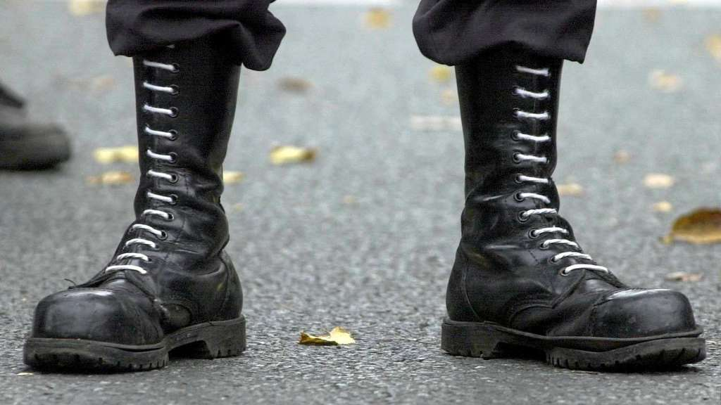 Privat123 (dpa files) - A rightist demonstrator wears their trademark combat boots during a rally in Dortmund, western Germany, 21 October 2000. In 2003 the number of recorded rightist extremists and Neo Nazis ready for violence has increased again, after their number had dropped in 2002, according to information of the Office for the Protection of the Constitution of the state of Baden-Wuerttemberg.